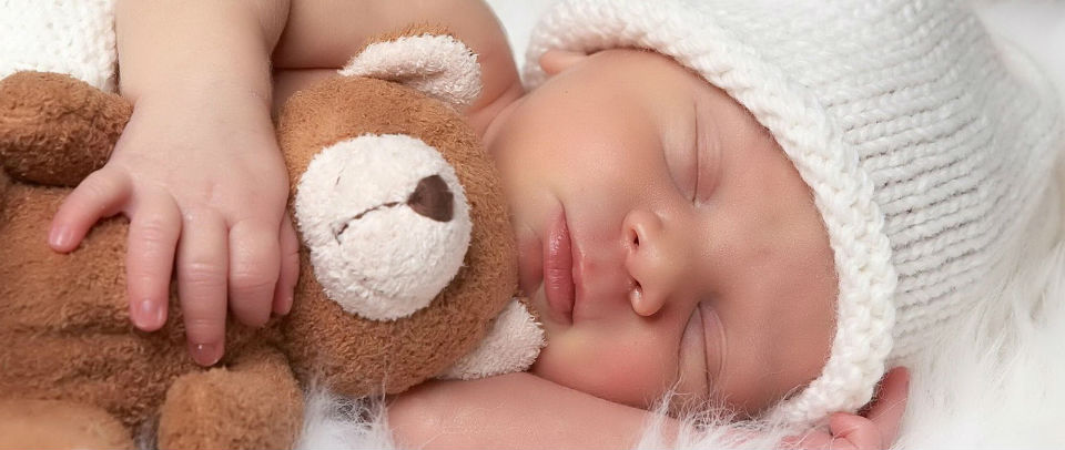 Baby with bear 960x450